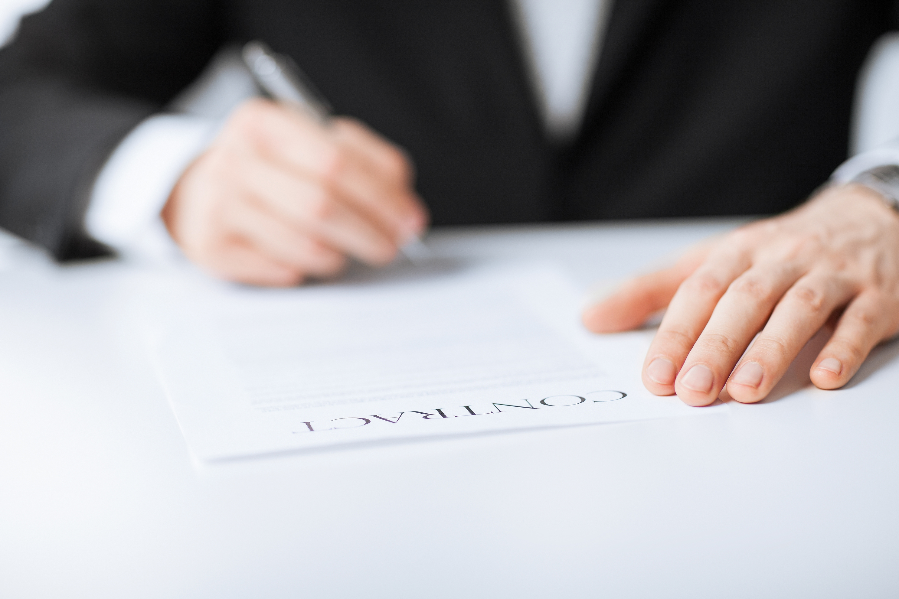 picture of man signing contract