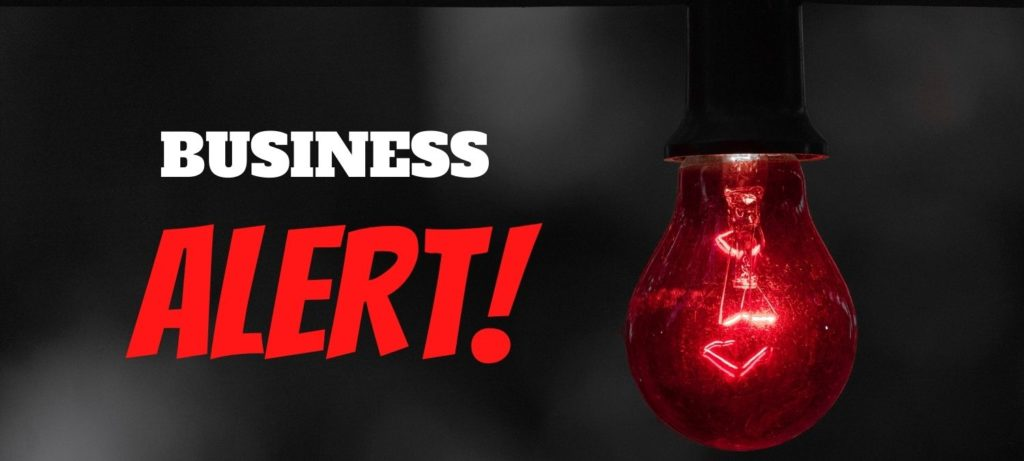 Business Alert graphic with red lightbulb