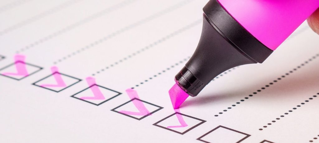 A checklist with pink highlighter pen